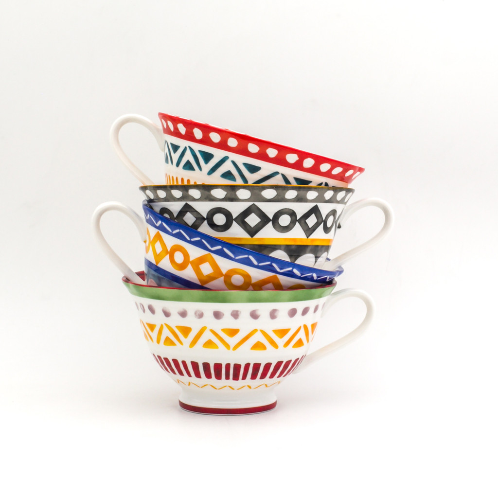 single stack of four large latte mugs with assorted colors and geometric patterns with the handles alternating