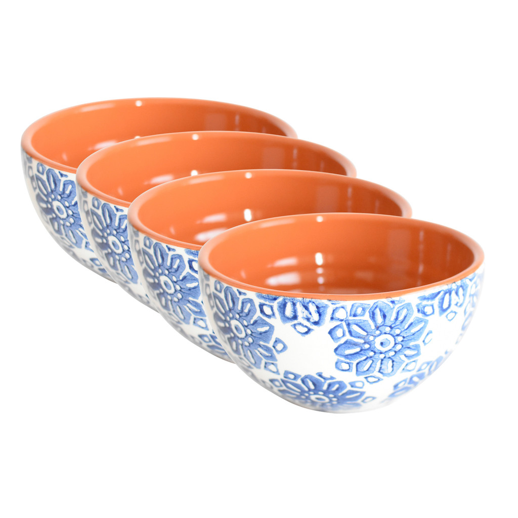 four cereal bowls with blue flowers on the outside and terra cotta on the inside