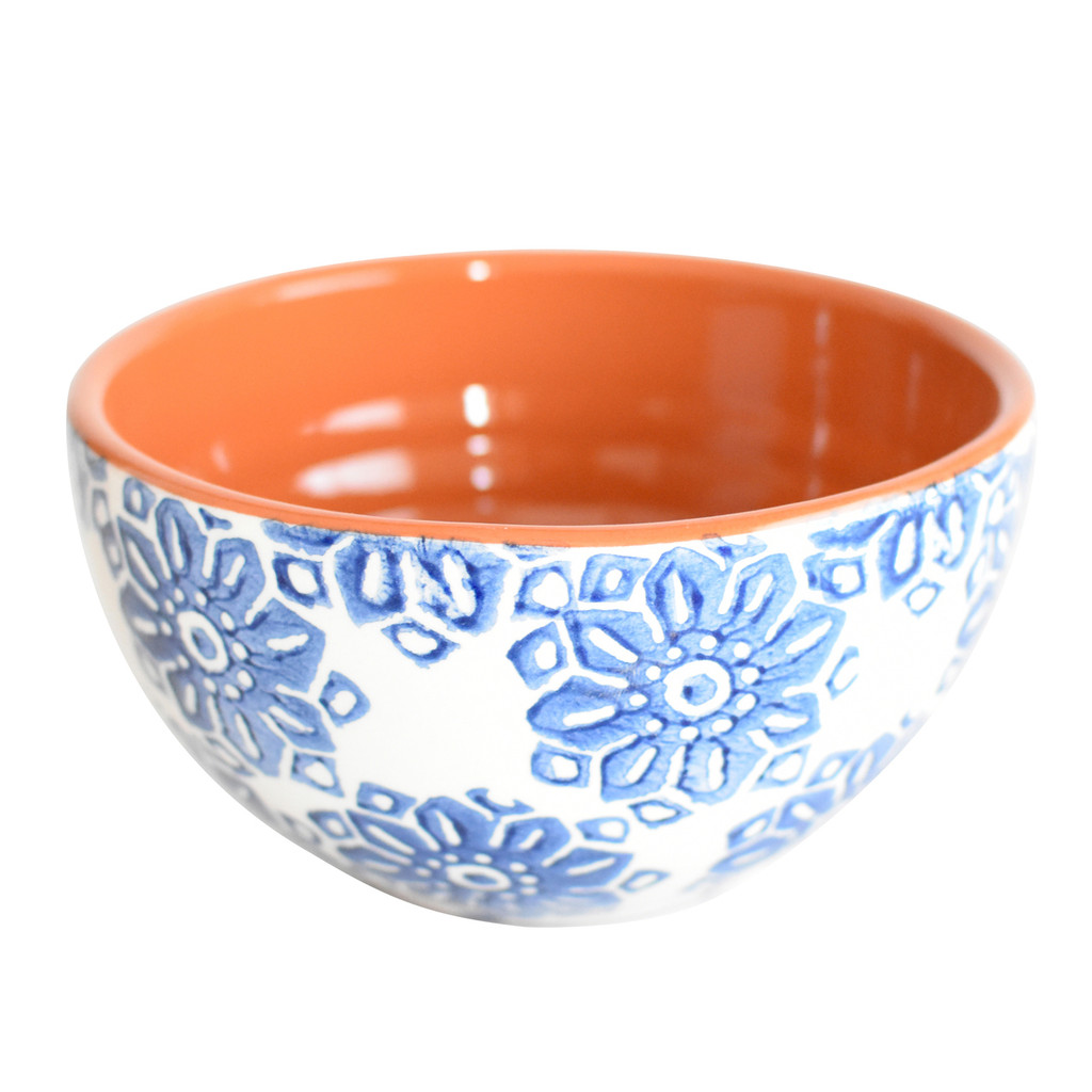 a single cereal bowl with blue flowers on the outside and terra cotta on the inside