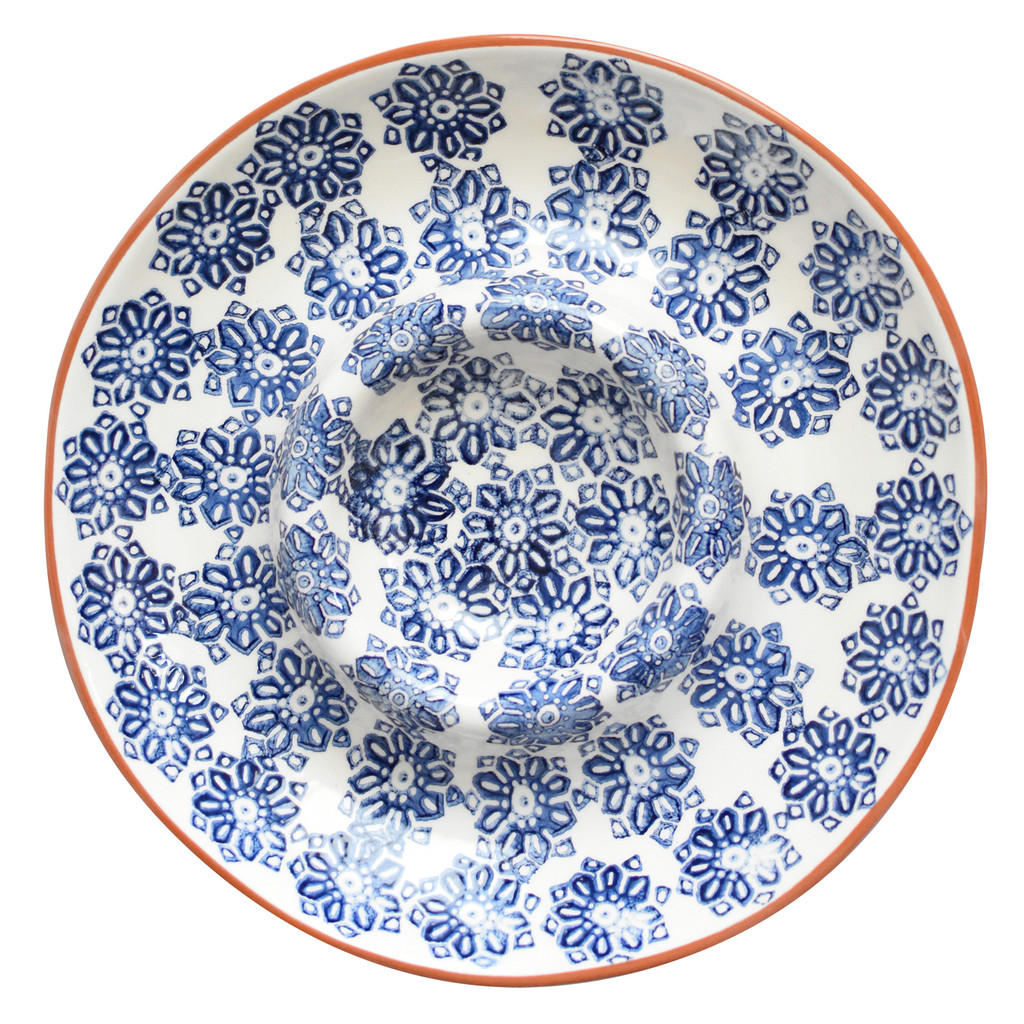 a large chip and dip platter with a central well and a blue flower design and terra cotta rim