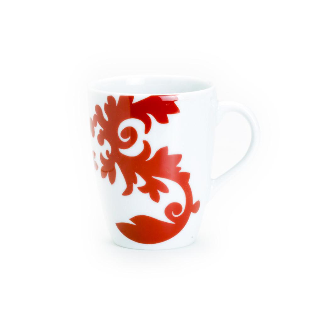 a mug with a large damask design on one side
