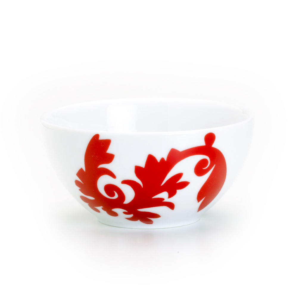 a bowl with a large damask design on one side