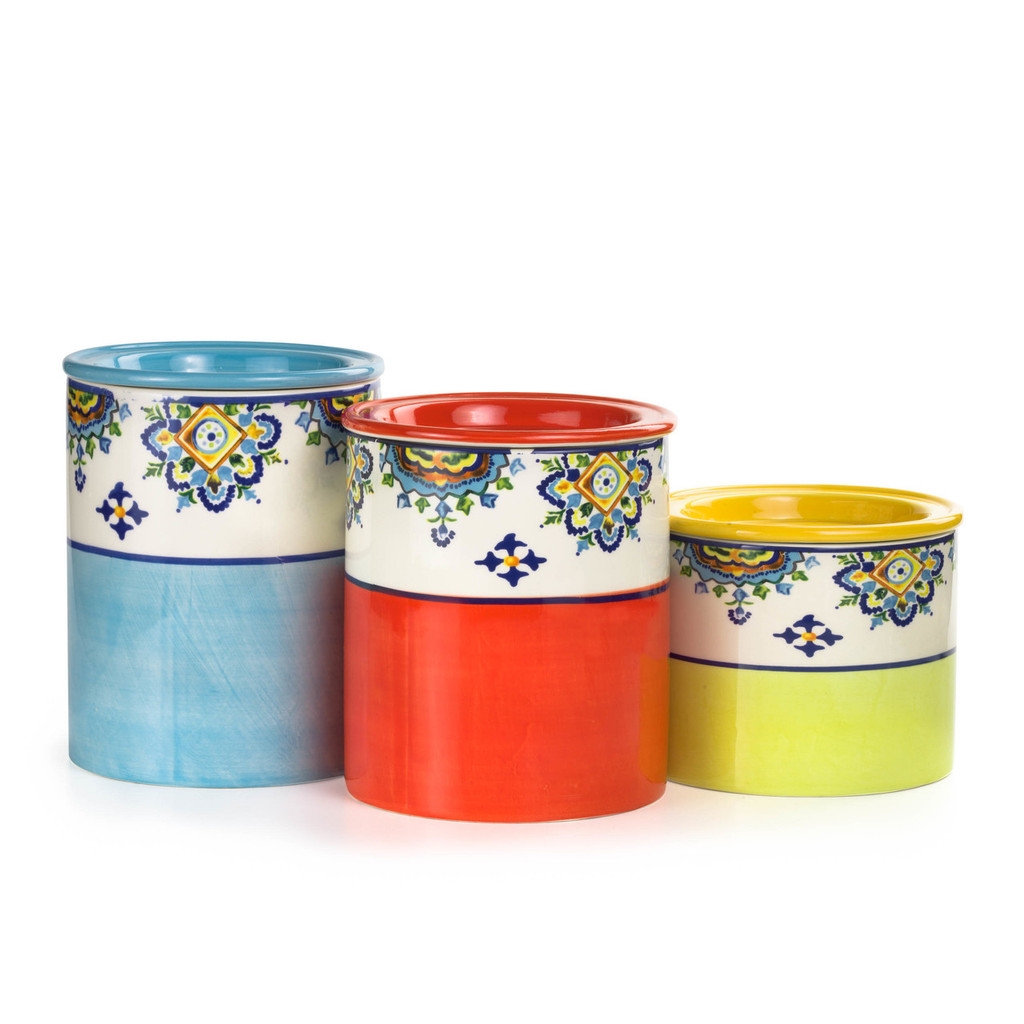 a large, medium and small canister in blue, red, yellow respectively