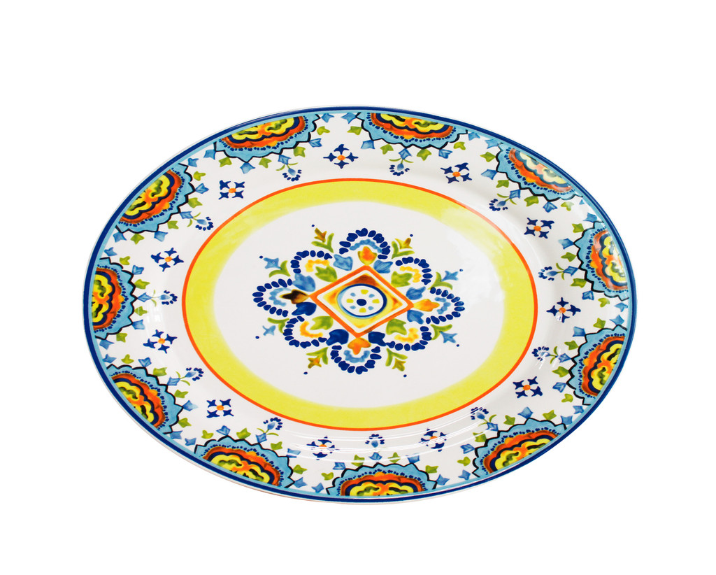 an oval platter with a colorful yellow, blue and red design