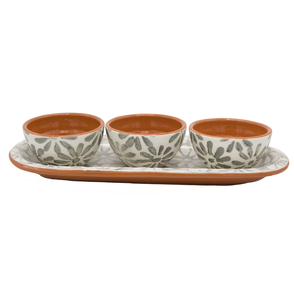 three dipping bowls with grey flowers and terra cotta interiors on a small grey platter with grey and white flowers