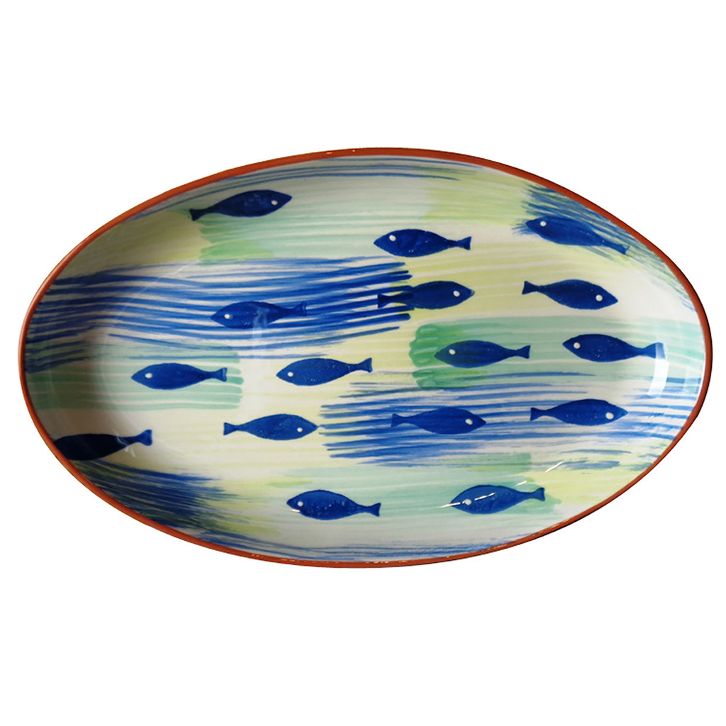 large oval platter with many hand-painted blue fish and a terracotta rim
