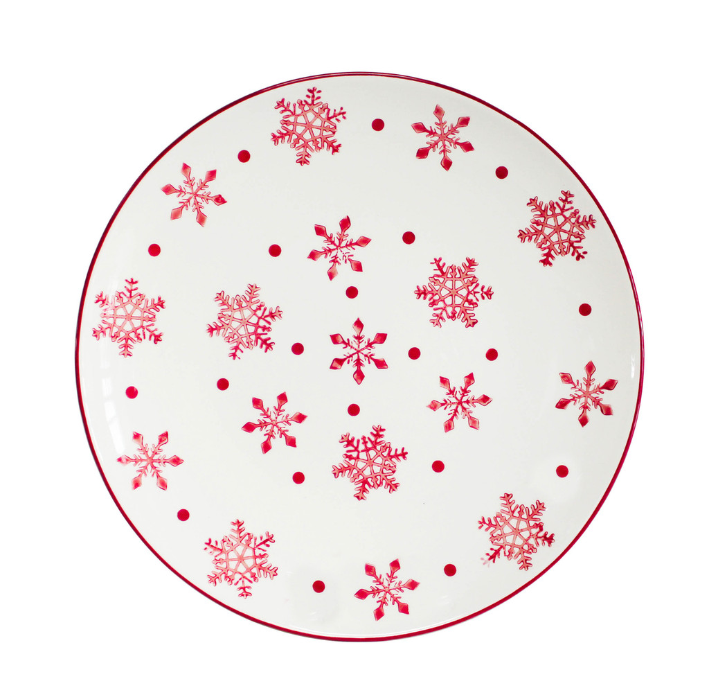 large white round platter with red snowflake designs