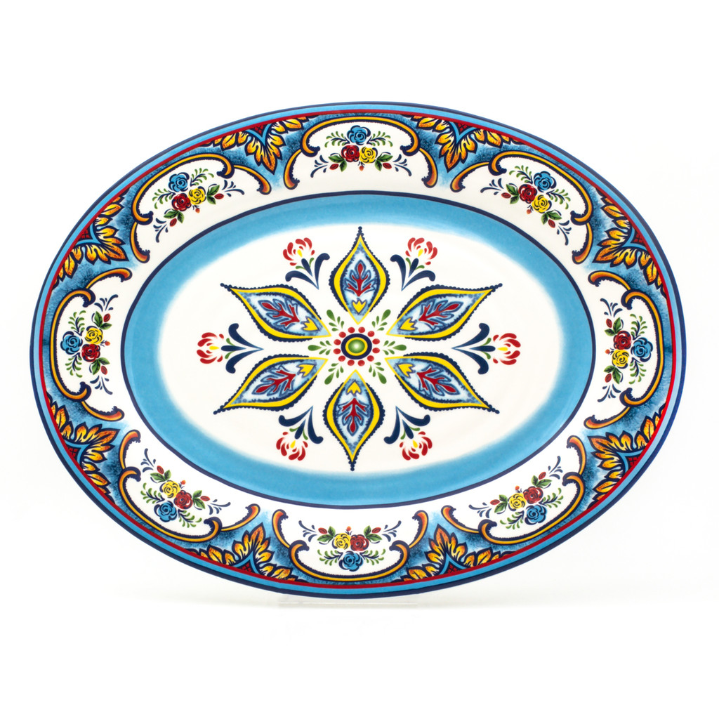 oval platter featuring a colorful feather floral design and blue brushwork