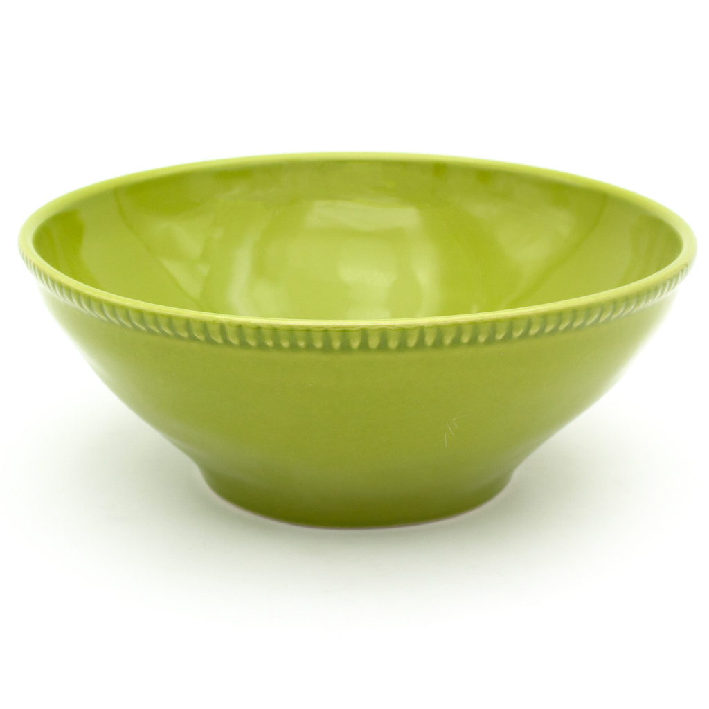 a large green serving bowl with beaded accents around the rim