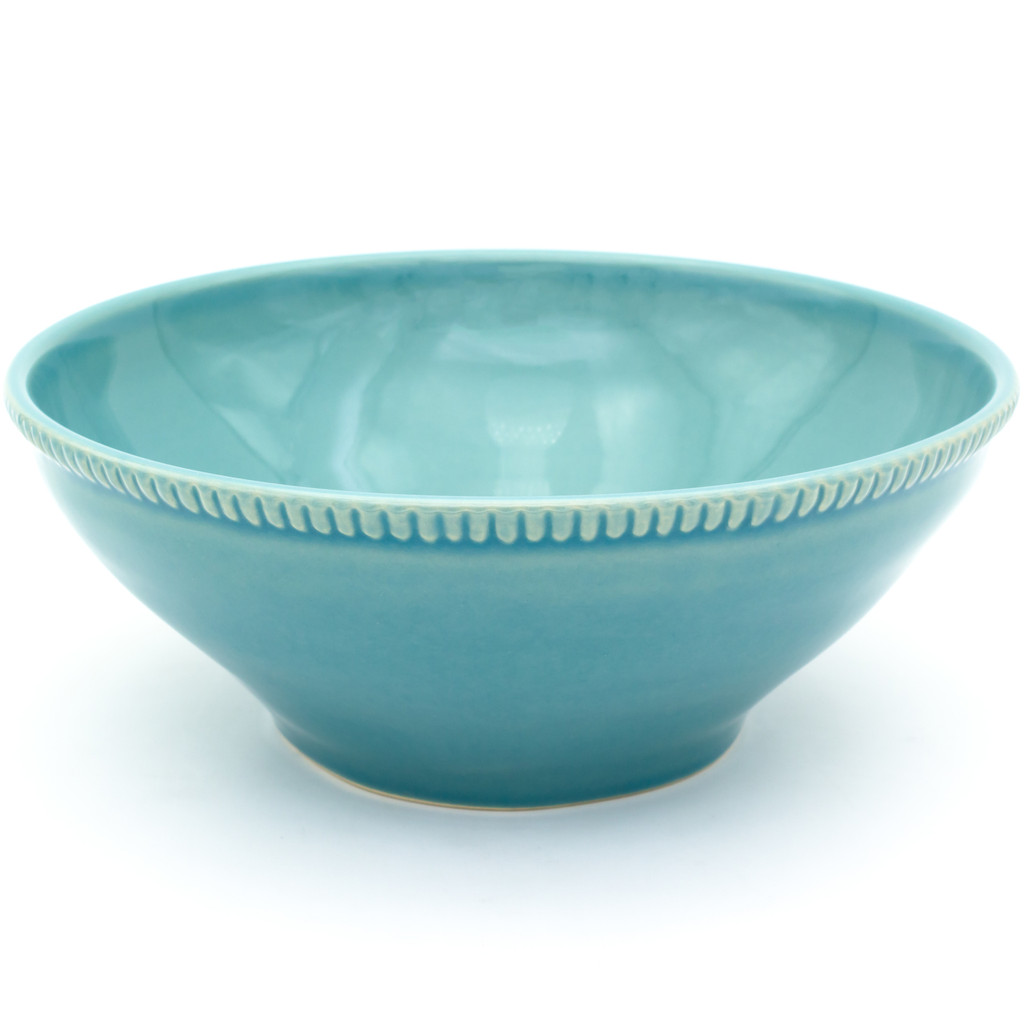 a large blue serving bowl with beaded accents around the rim