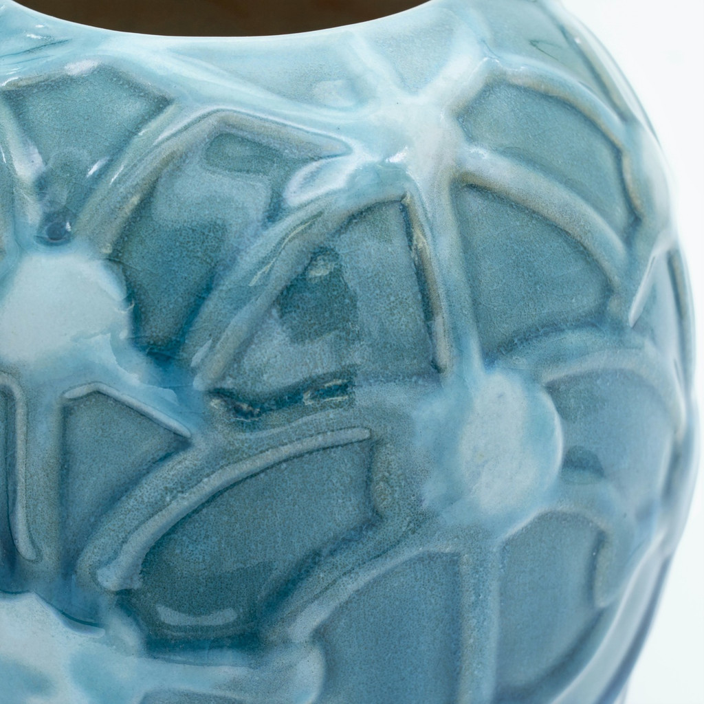 detail shot of a Small round turquoise vase with an embossed rope design showing a crackle effect in the glaze and variations in the color