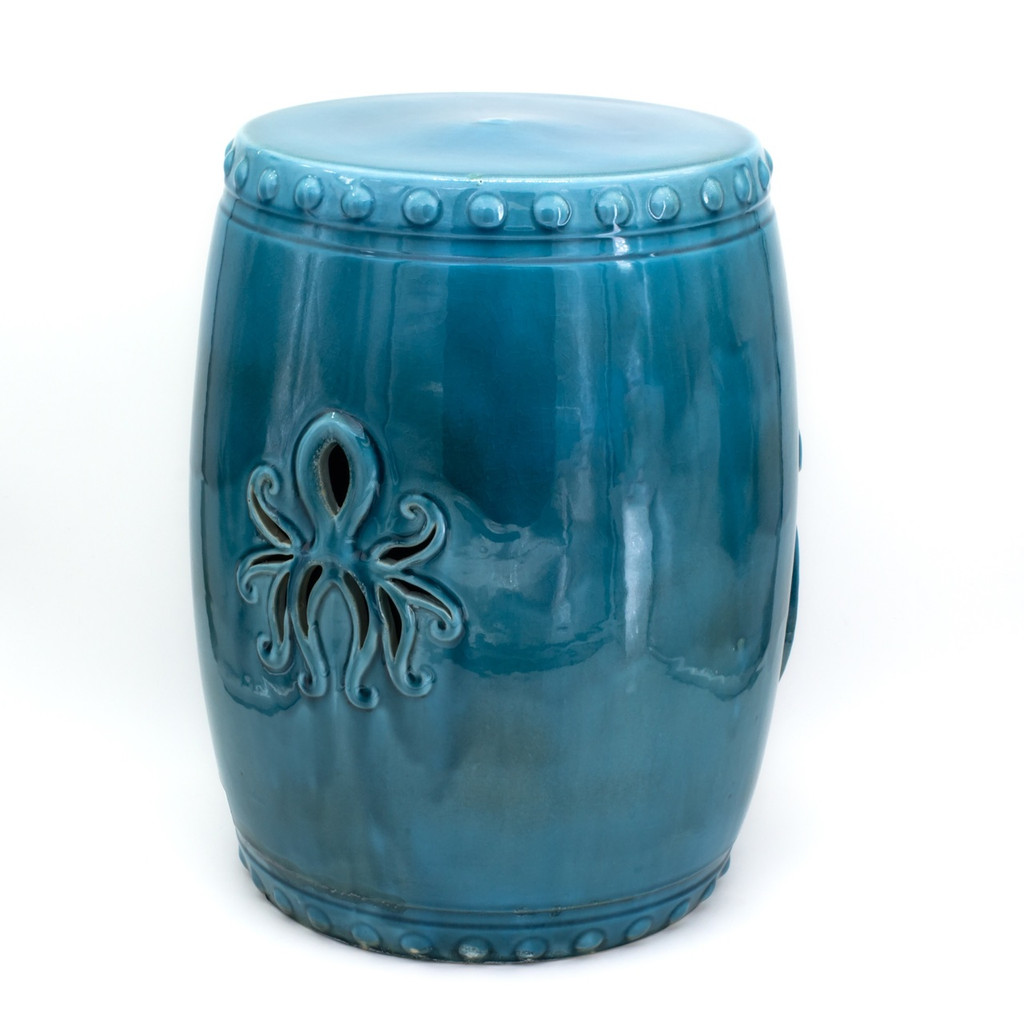 back view of drum shaped turquoise stool showing a smaller carved octopus figure on the back