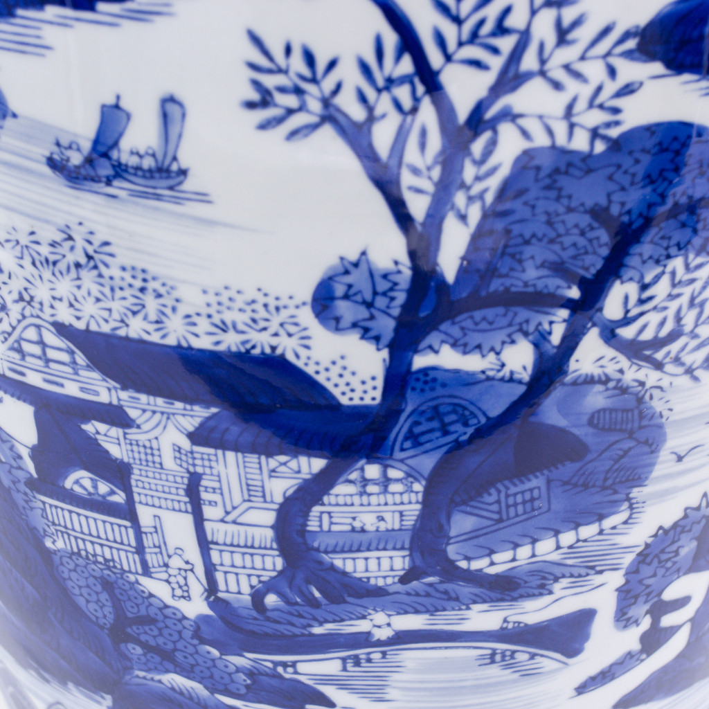 detail view of drum shaped blue and white hand-painted stool featuring a traditional chinese landscape painting  showing the brushwork of the painting