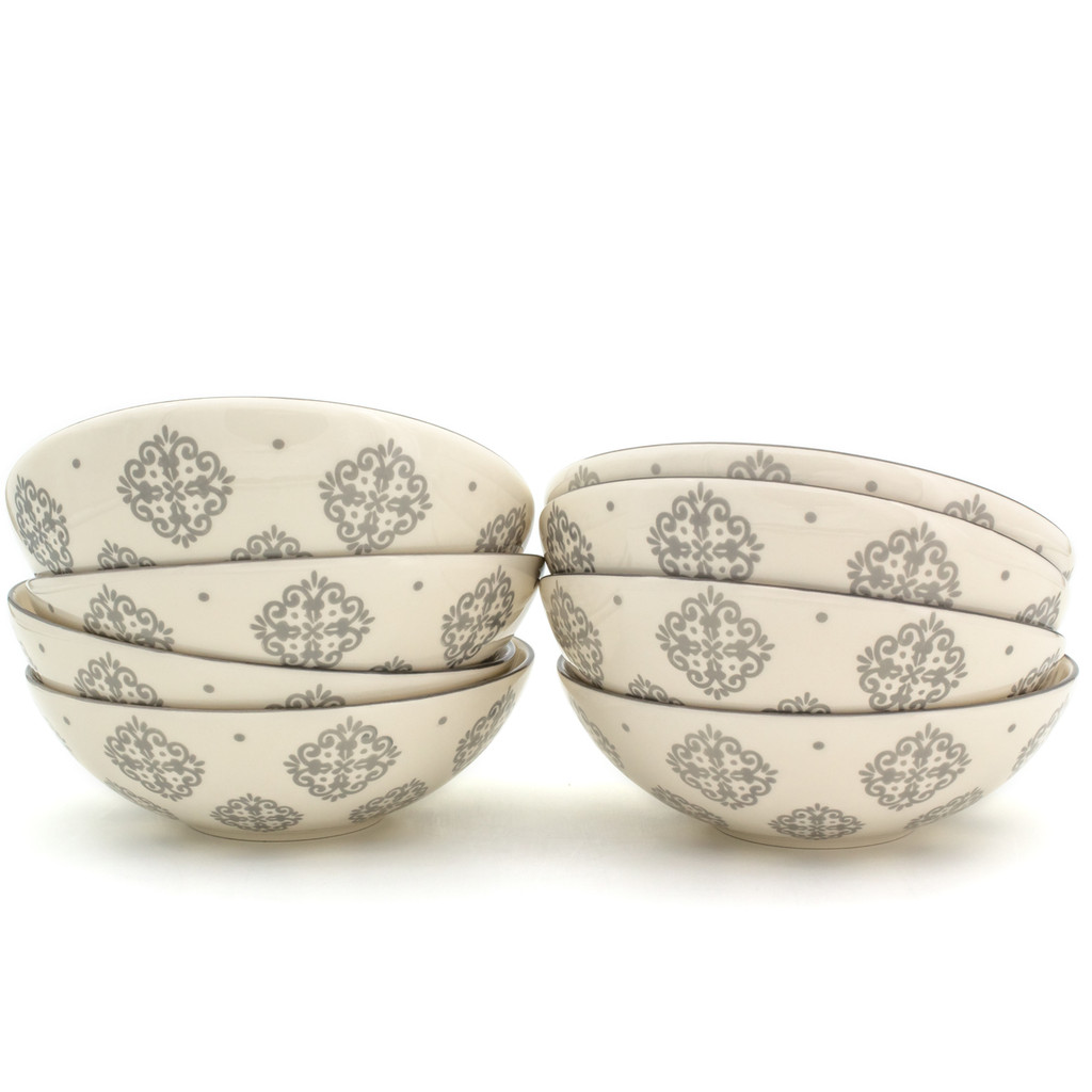 8 white bowls with grey patterns in two stacks