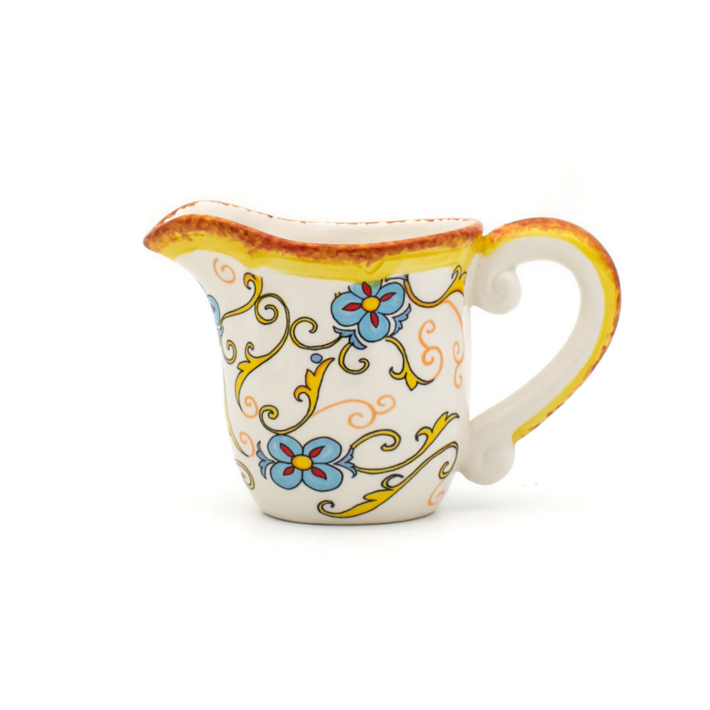 photo of creamer with floral decal pattern