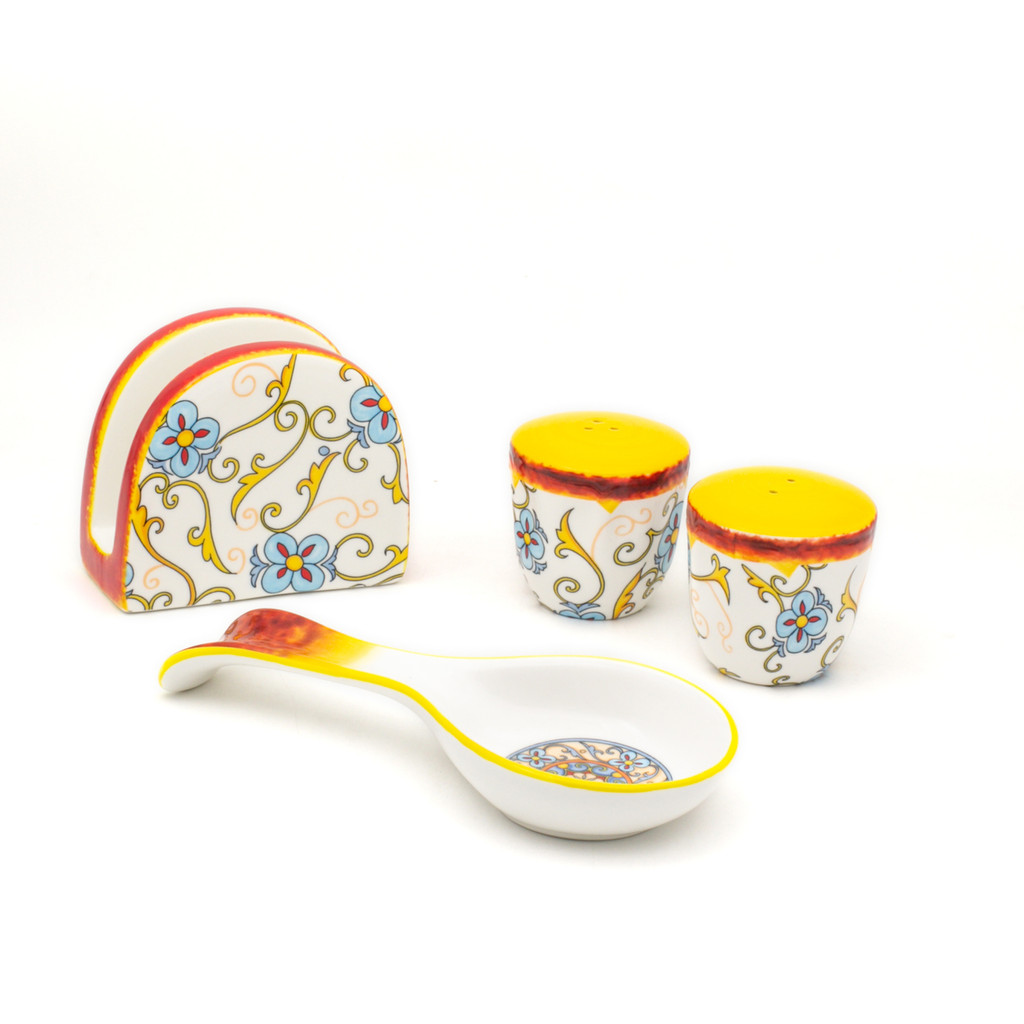 photo of spoon rest, napkin holder, salt shaker, pepper shaker, with floral decal pattern