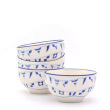 """four white bowls with various blue """"flag language"""" flags arranged on their exteriors. three bowls are stacked on in front"""