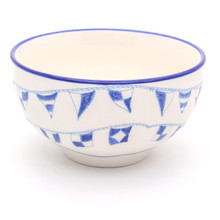 """a single white bowl with blue """"flag language"""" flags around its exterior and a blue rim"""