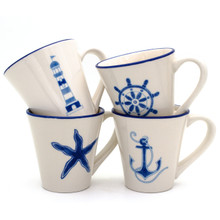 four white cups with assorted blue nautical designs and blue rims. the cups feature a lighthouse, a ships wheel, a starfish, and an anchor. all four cups are stacked