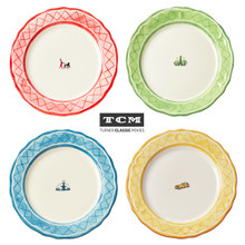 four dinner plates with red, green, blue and yellow rims. each plate features a different icon in the middle: woman walking her dog, a fountain, a building, a car