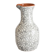 wine carafe with a grey and white floral design and a terra cotta interior