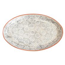 a large oval platter with a grey body and white flowers and a terra cotta exterior