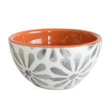 one small white cereal bowl with grey flowers and a terracotta interior