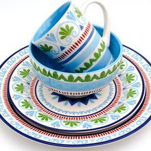 place setting of a dinnerware set with a blue and green design, all pieces stacked