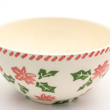 detail of a single individual bowl with a holly and berry design