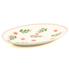 side view of oval platter with holly and berry pattern