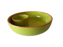 green chip and dip with small attached dip cup on the side of the tray with a terracotta rim