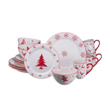 16 piece white dinnerware set with red snowflake and assorted snowmen, trees, gingerbread, and reindeer designs