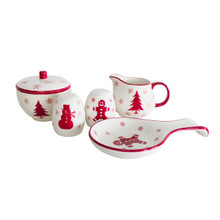 white accessory set with red holiday themed designs : snowflake creamer, tree lidded sugar, ginger bread spoon rest, snowman shaker, gingerbread shaker