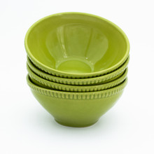 Four green cereal bowls with beaded detail around the rim displayed in a stack