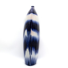 Side View of Blue and White Vase with Dripped Glaze Effect