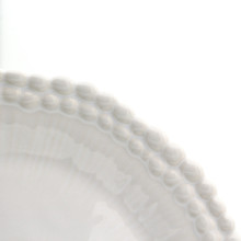 detail showing two rings of beaded engraving around the rim of a salad plate
