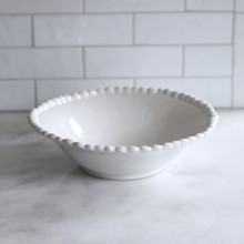 wide lipped white bowl with beaded rim