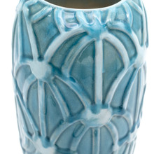 Detail of a Skinny tall turquoise cylinder vase with an embossed rope design showing crackle effect in the glaze and variations in the color
