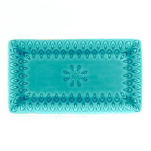 lagoon rectangular platter with crackle glaze and an embossed peacock feather design