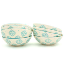 8 white bowls with turquoise patterns in two stacks