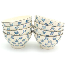 8 white bowls with blue patterns in two stacks