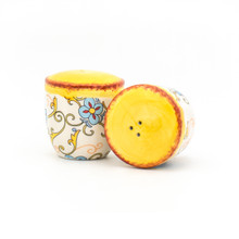 photo of salt shaker, pepper shaker, with floral decal pattern