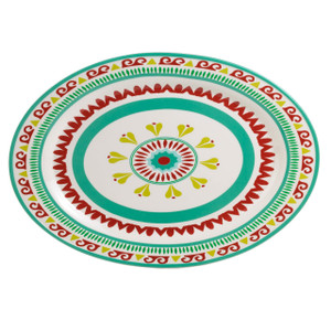 an oval platter featuring a multicolor design of greens, yellows and reds