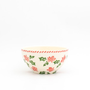 a single individual bowl with a holly and berry design