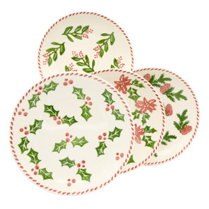 four assorted design salad plates featuring variations on a holly and berry design