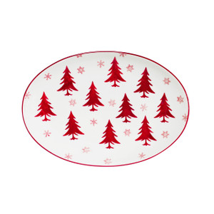 white oval platter with red trees
