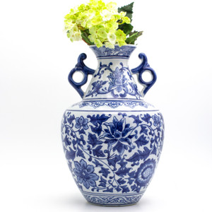 Lifestyle shot of Traditional chinese blue and white handled vase featuring artificial yellow flowers in the vase