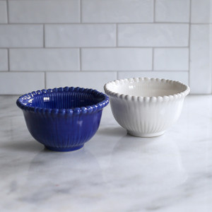 two bowls with beaded rims and engraved sides, one blue one white