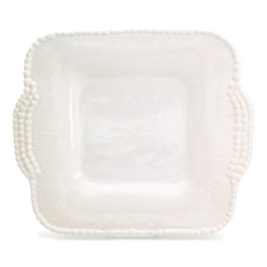 large square platter in white with handles and beads around the edge, with an extra line of beads on the handles