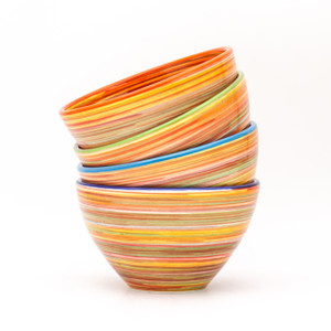 Experience the joy of painting with the Raia Collection by Euro Ceramica.  Completely hand-painted by Spanish artisans, every stripe and swirl of the Raia design is unique to the character of that piece. With no two plates exactly alike, the charm of the colorful rainbow of oranges or blues will shine on any table. Each set in the collection comes in an assortment of four rim colors - cobalt, turquoise, green, and orange – lending even more distinction to the dishes and opening a world of mix-and-match potential.  The Cereal Bowl set includes four bowls with a generous 24oz capacity and steep walls, perfect for everything from cereal to ice cream to a heaping bowl of warm soup. Dishwasher and Microwave safe, Raia lends itself to that every night casual meal, but can also easily be dressed up for a full tablescape.  To create your perfect table setting, skip the salad and lay the Raia bowl directly on an oversized white dinner (like our Algarve plates!) for a striking combination. Guests can use the bowl for salad or save it for the desert!